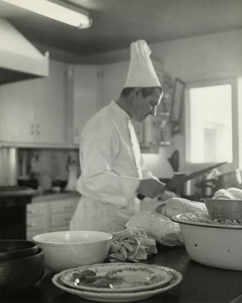 Uniform Photograph - Chef Cooking At Elizabeth Arden's Maine Chance by Karen Radkai