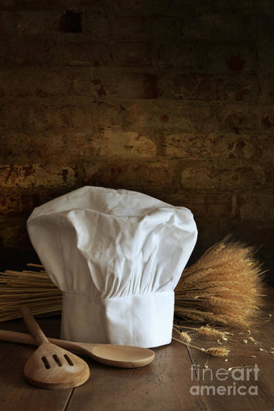 Photograph - Chef Hat And Spoons With Brick Background by Sandra Cunningham