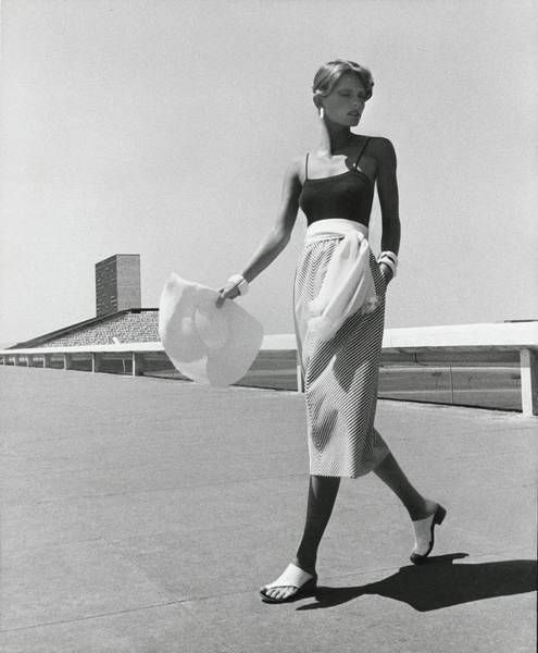 Holiday Photograph - Cheryl Tiegs Wearing A Blassport Skirt by Kourken Pakchanian