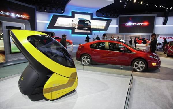 Detroit Auto Show Photograph - Chevrolet Electric Cars by Jim West