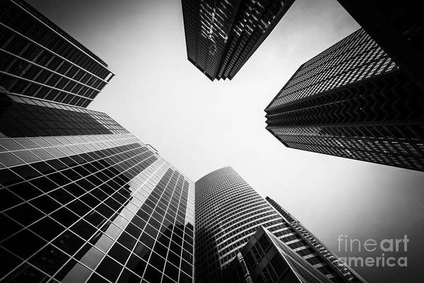 Between Photograph - Chicago Buildings In Black And White by Paul Velgos