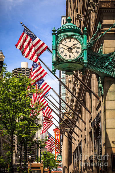 Editorial Photograph - Chicago Macy's Clock And Chicago Theatre Sign by Paul Velgos