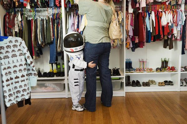 Child (4-5 Yeras) Wearing Space Costume Hugging Mother's Leg In Shop Art Print by Inti St. Clair