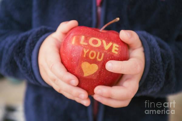 Wall Art - Photograph - Child Holding Apple by Viktor Pravdica
