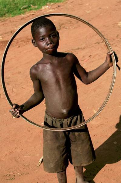 Hoop Photograph - Child Playing With A Hoop by Mauro Fermariello/science Photo Library