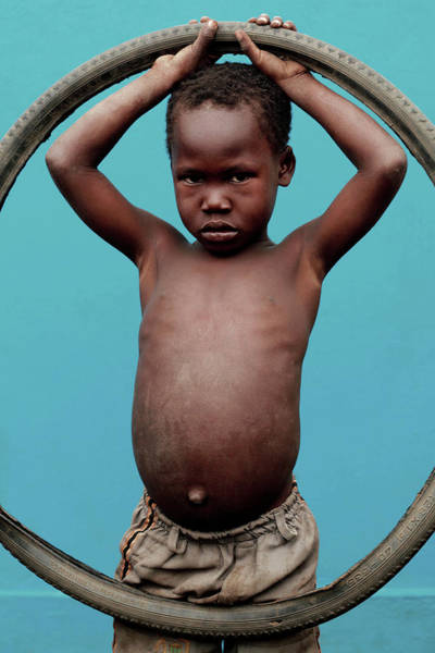 Tyre Wall Art - Photograph - Child With Bicycle Tyre by Mauro Fermariello/science Photo Library