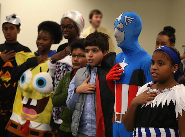 Children Attend Halloween-themed U.s. Citizenship Ceremony In Baltimore Art Print by Mark Wilson
