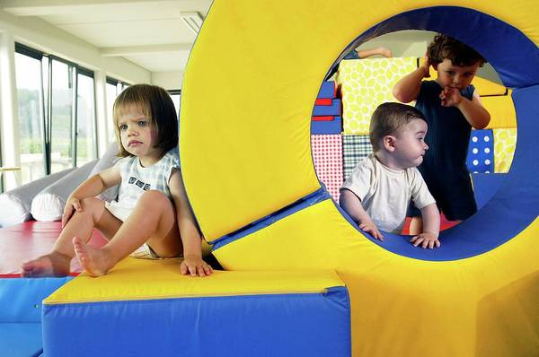 Wall Art - Photograph - Children Playing In A Nursery by John Thys/reporters/science Photo Library