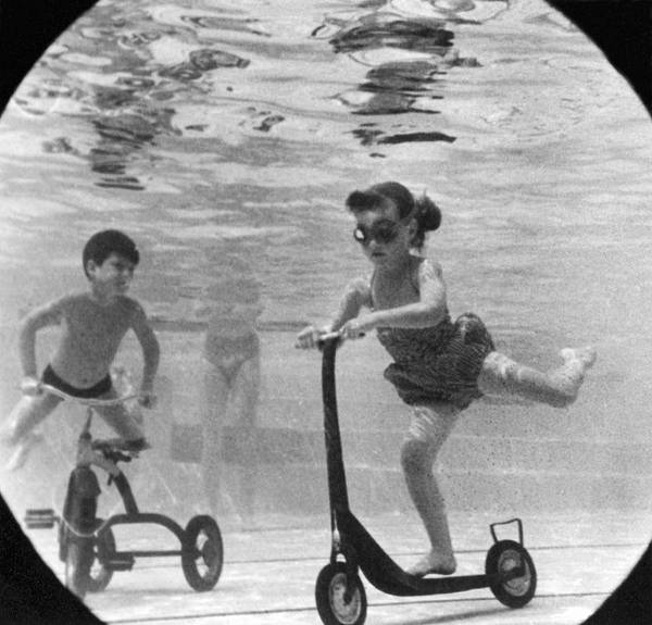 1958 Photograph - Children Playing Under Water by Underwood Archives