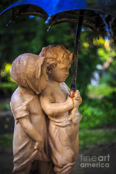 Photograph - Children Under Umbrella Genoese Park Cadiz Spain by Pablo Avanzini