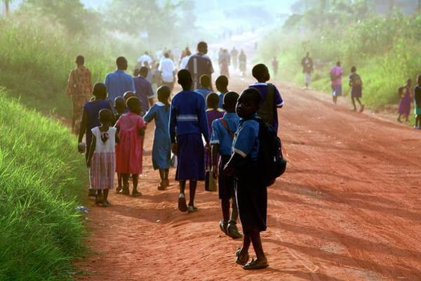 Uganda Wall Art - Photograph - Children Walking Along A Road by Mauro Fermariello/science Photo Library