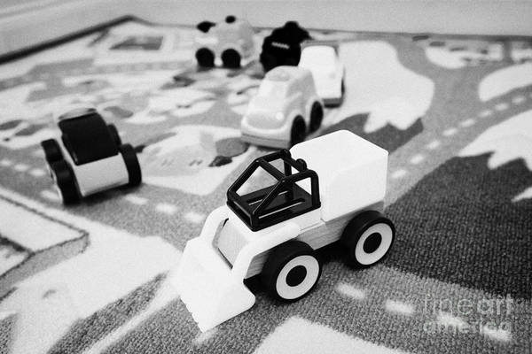 Wall Art - Photograph - Childs Toy Cars And Construction Set On A Road Playmat by Joe Fox