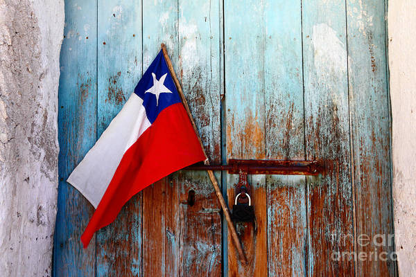 Photograph - Chilean Flag On Old Wooden Door by James Brunker