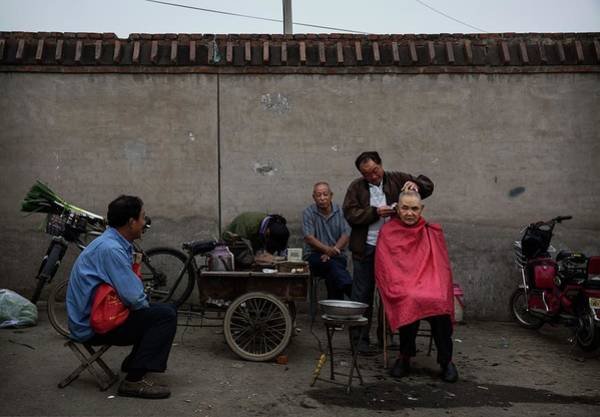 Hairstyle Photograph - China Daily Life - Food by Kevin Frayer