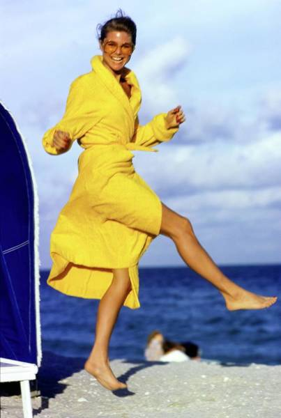 Christie Brinkley Photograph - Christie Brinkley Wearing A Yellow Robe by Arthur Elgort