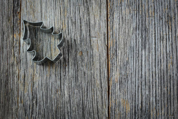 Photograph - Christmas Tree Cookie Cutter On Rustic Wood Background by Brandon Bourdages