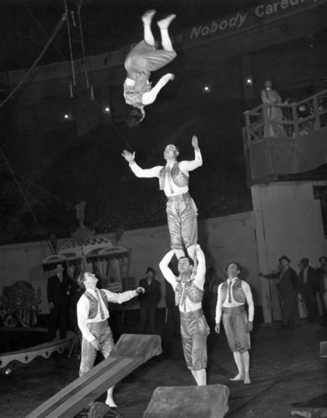 Bailey Photograph - Circus Acrobats Practicing by Underwood Archives