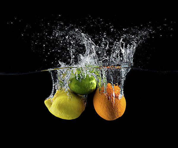 Citrus Fruit Photograph - Citrus Splash by Mogyorosi Stefan