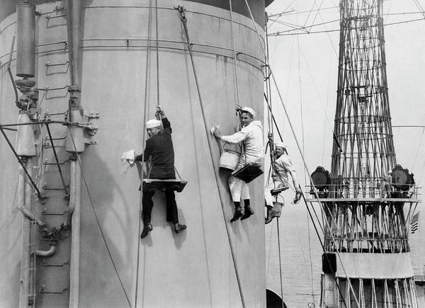 Photograph - Cleaning A Battleship by Underwood Archives