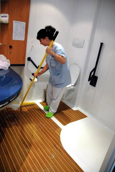 Wall Art - Photograph - Cleaning The Bathroom In A Care Home by Aj Photo/science Photo Library