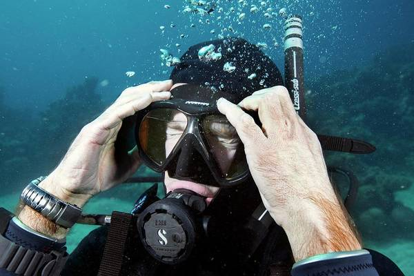 Wetsuit Wall Art - Photograph - Clearing Water-filled Diving Mask by Louise Murray