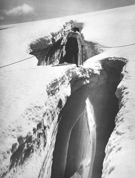 Crevasses Photograph - Climber Crossing An Ice Bridge by Underwood Archives