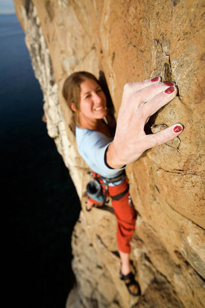 Agile Photograph - Climber Grabs A Hold While Climbing by Corey Rich