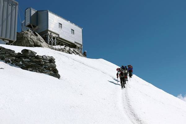 Mont Blanc Wall Art - Photograph - Climbers At Vallot Hut by Martin Rietze