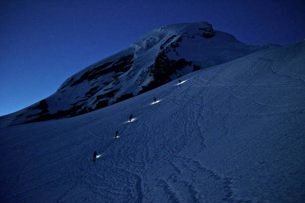 Wall Art - Photograph - Climbers Wearing Headlamps Climb Mount by Marc Pagani