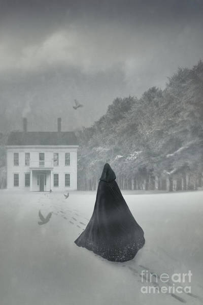 Photograph - Cloacked Figure Walking In The Snow With House In Distance by Sandra Cunningham
