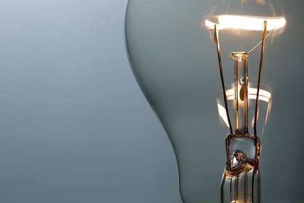 Close Up Glowing Light Bulb Art Print by Bernie_photo