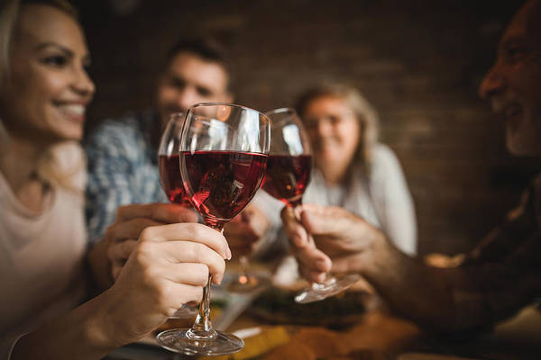 Close Up Of A Family Toasting With Red Wine At Home. Art Print by Skynesher