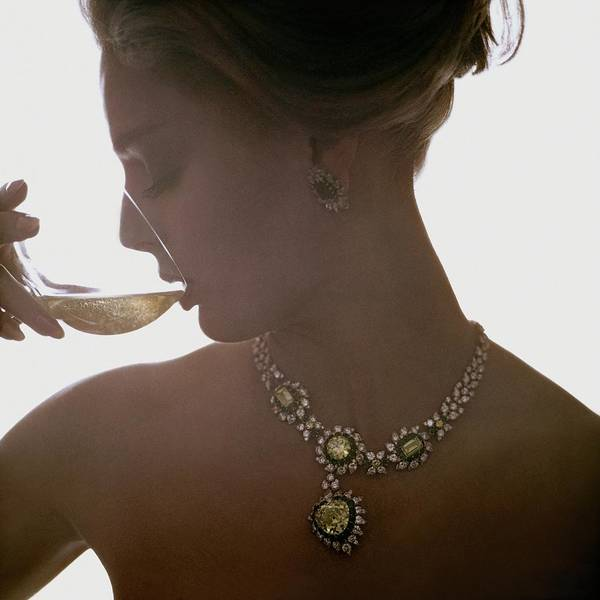 Photograph - Close Up Of A Young Woman Wearing Jewelry by Bert Stern
