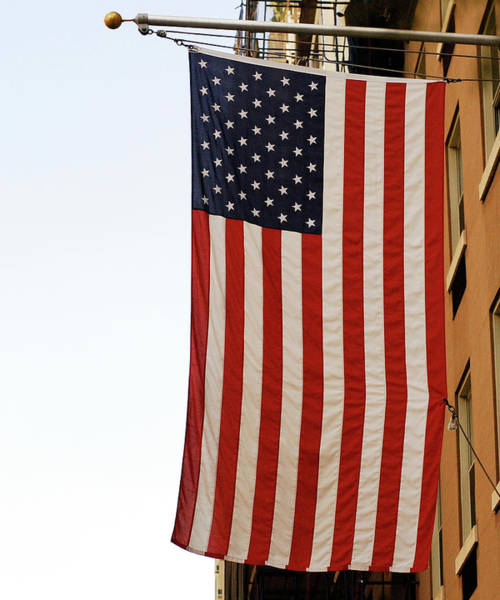 Hanging Photograph - Close Up Of American Flag Hanging From by Lyn Holly Coorg