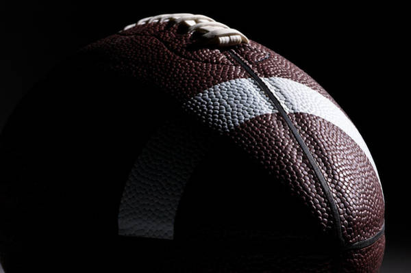 Close-up Of American Football With Dramatic Lighting Art Print by Kledge