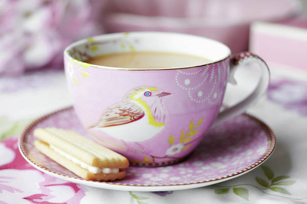 Break Up Photograph - Close Up Of Cup Of Tea And Cookie by Debby Lewis-harrison