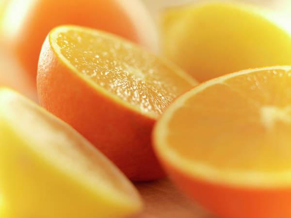 Lemon Photograph - Close Up Of Cut Lemons And Oranges by Adam Gault