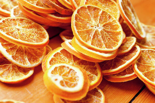 Slice Photograph - Close Up Of Dried Orange Slices by Nils Hendrik Mueller