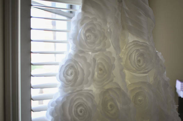 Wall Art - Photograph - Close-up Of Flower Wedding Dress by Mike Hope