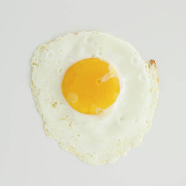 Sunny Side Up Wall Art - Photograph - Close Up Of Fried Egg, Studio Shot by Jamie Grill