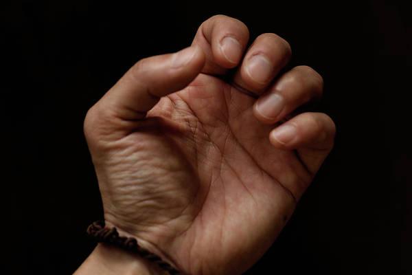 Photograph - Close Up Of Hand With Dark Background by Yuko Yamada