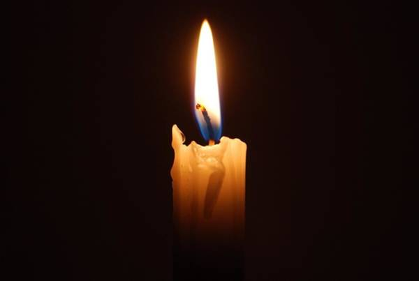 Close-up Of Lit Candle In Dark Room Art Print by Lau Vzquez / EyeEm