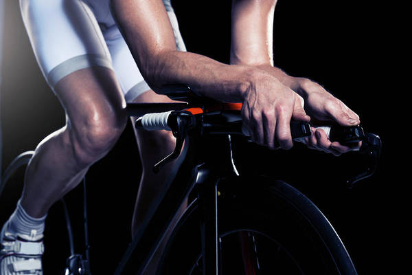 Sport Photograph - Close-up Of Man Cycling, Studio Shot by Johner Images