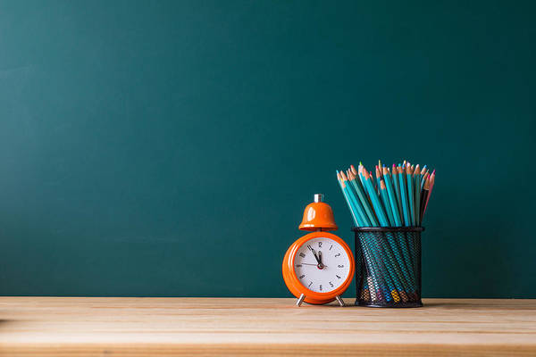 Close-up Of Pencils In Container By Alarm Clock On Table Art Print by Shih Wei Wang / EyeEm