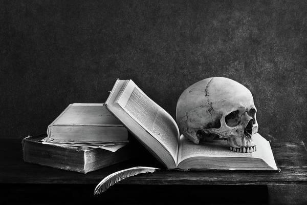 Photograph - Close-up Of Skull On Book by Jakkapan Jabjainai / Eyeem