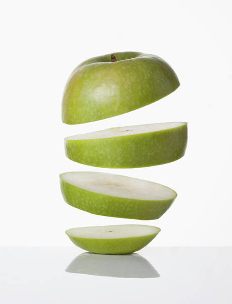 Slice Photograph - Close Up Of Slices Of Apple by Walter Zerla