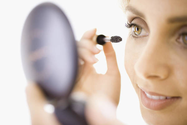 Close-up Of Woman Applying Makeup Art Print by Jupiterimages, Brand X Pictures