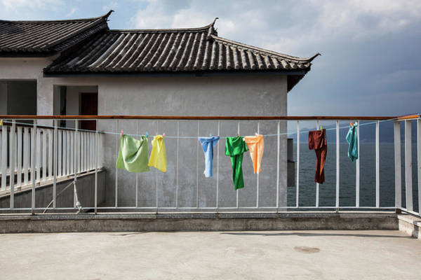 Balcony Photograph - Clothes Hang To Dry On A Line In Dali by Aaron Joel Santos