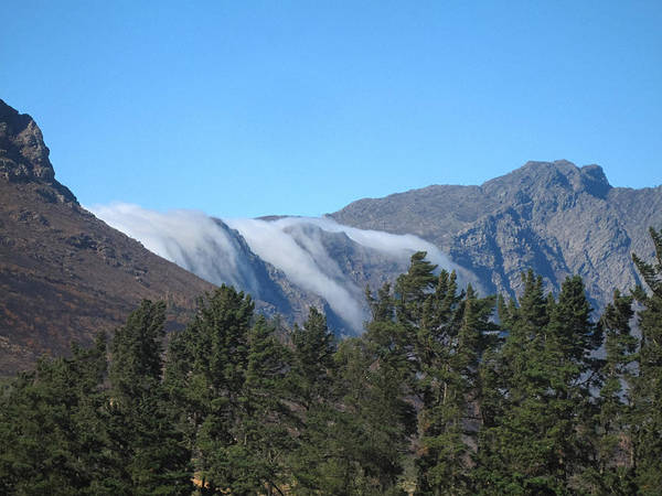 Clouds Flowing Over The Mountains Art Print