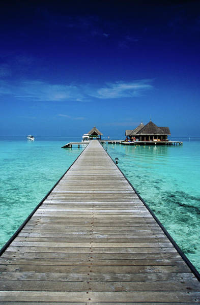 Green Day Photograph - Club Med Kani, Long Pier Surrounded By by Izzet Keribar